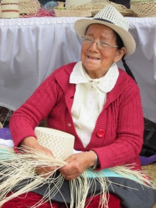 precious lady making a straw hat