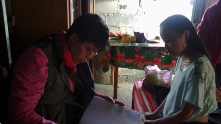 Palliative Care Dr. Susan Lua Nava Reviewing Documents with Cancer Patient